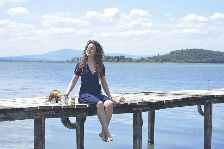 Lucia sitting on boardwalk